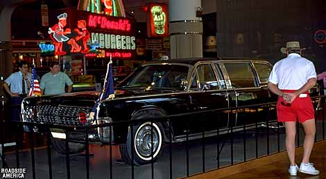 Kennedy's Death Car (a 1961 Lincoln) and an exhibit of fast food signage.